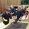 Playing together in the new mud kitchen